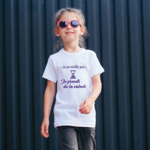 T‑shirt en coton bio col rond Enfant - Je ne vieillis pas je prends de la valeur